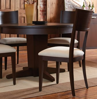 Round pedestal based tables offer more seating and leg room to smaller spaces.