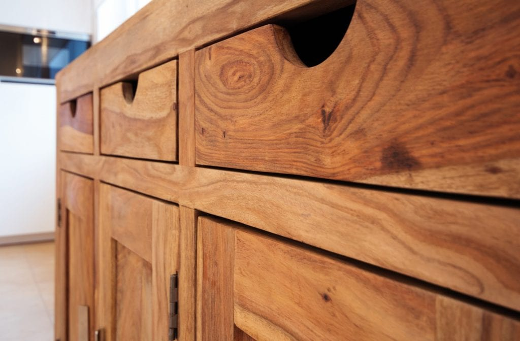 close up of a wooden cabinet with 3 drawers and 3 cupboards