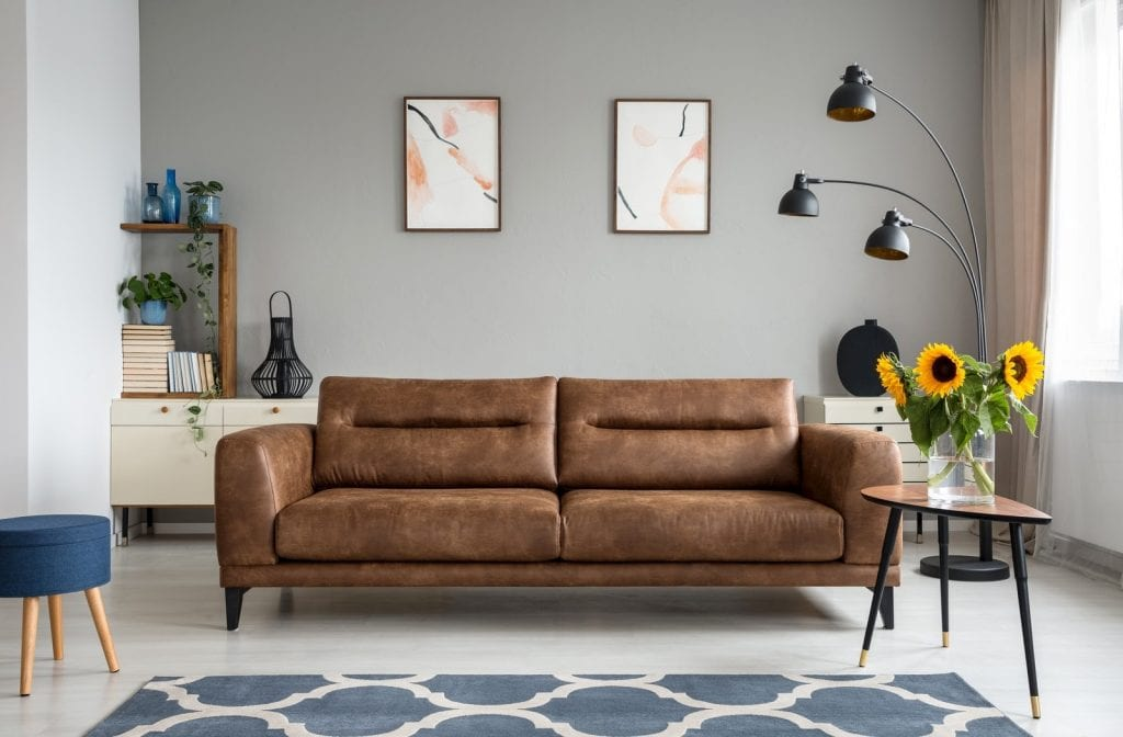 A high-quality leather couch sitting in a decorative living room