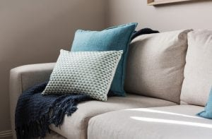 Close up of a fabric sofa with styled cushions